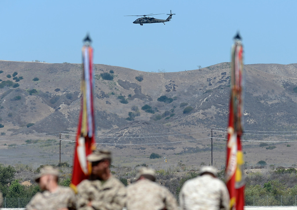 . CAMP PENDLETON, CA - AUGUST 07:  A U.S. Marine Corps military helicopter passes as members of USMC wait for the arrival of U.S. President Barack Obama to deliver remarks during his visit at Camp Pendleton Marine Corps base on August 7, 2013 in Camp Pendleton, California. Obama announced today that he canceled a planned meeting with Russian President Vladimir Putin in Moscow amid tensions over National Security Agency leaker Edward Snowden and other issues.  (Photo by Kevork Djansezian/Getty Images)