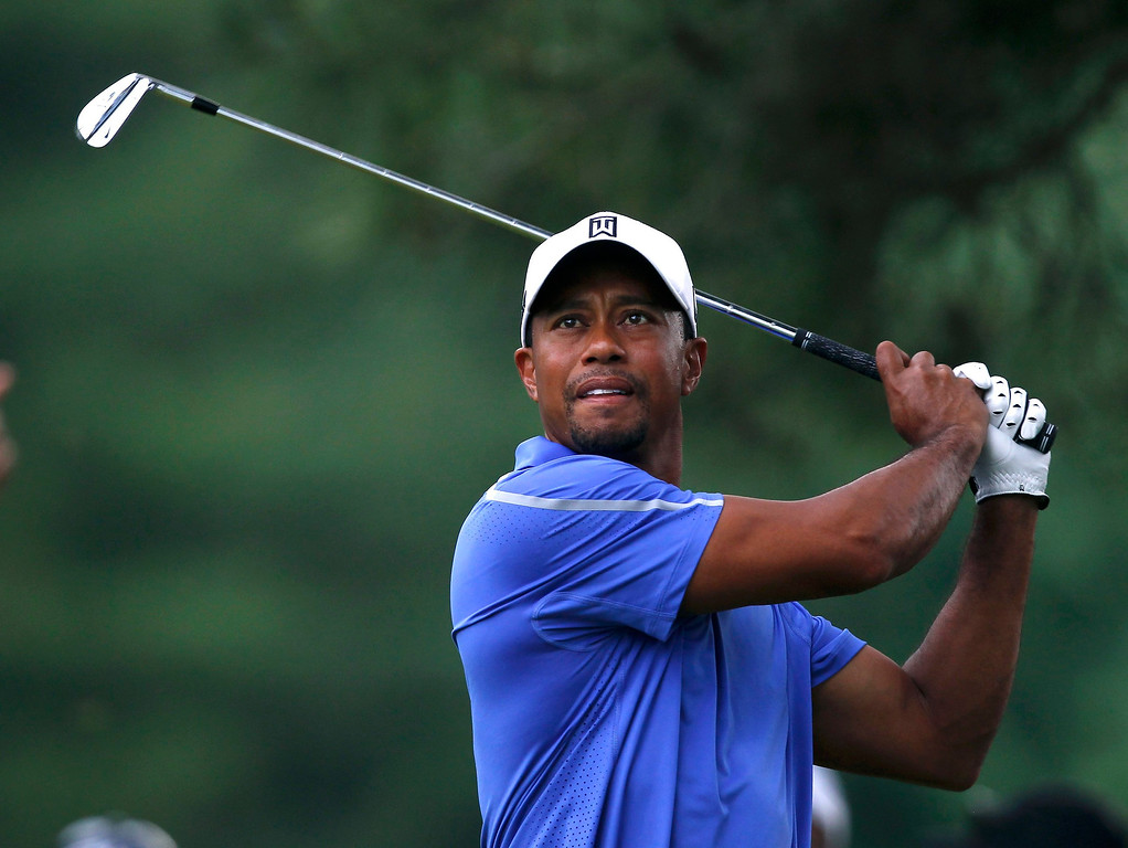 . Tiger Woods of the U.S. watches his shot from the eighth tee during the first round of the 2013 U.S. Open golf championship at the Merion Golf Club in Ardmore, Pennsylvania, June 13, 2013. REUTERS/Matt Sullivan