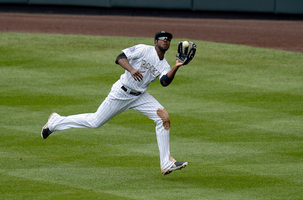 . Dexter Fowler (24) of the Colorado Rockies catches a Chris Stewart (19) of the New York Yankees fly ball in the fourth inning May 9, 2013 at Coors Field. (Photo By John Leyba/The Denver Post)