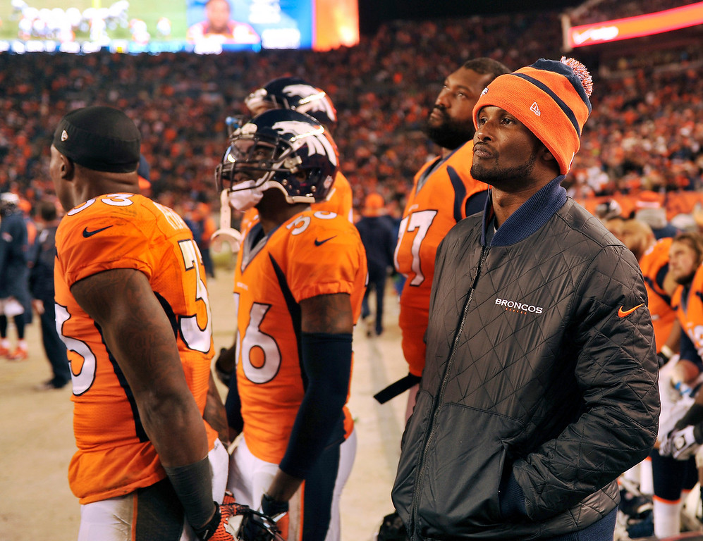 . Denver Broncos cornerback Champ Bailey (24) watches the Broncos lose to the Chargers 27 to 20.  The Denver Broncos vs. the San Diego Chargers at Sports Authority Field at Mile High in Denver on December 12, 2013. (Photo by Hyoung Chang/The Denver Post)