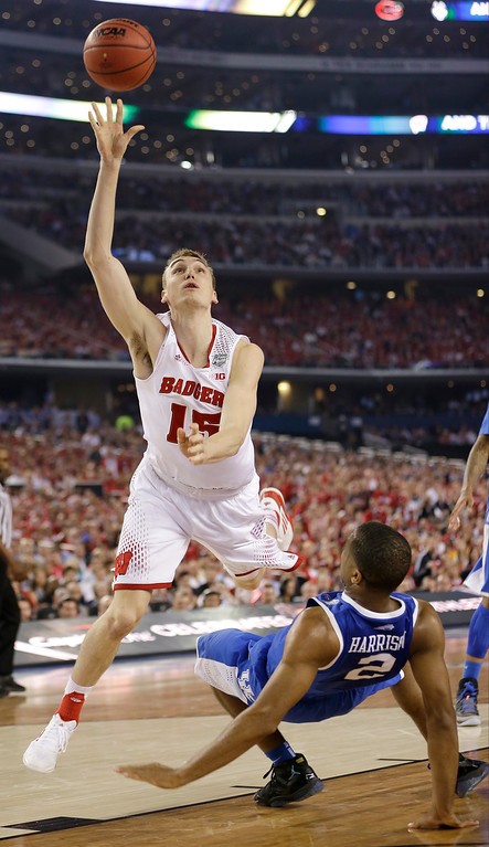 . Wisconsin forward Sam Dekker (15) shoots over Kentucky guard Aaron Harrison during the first half of an NCAA Final Four tournament college basketball semifinal game Saturday, April 5, 2014, in Arlington, Texas. (AP Photo/David J. Phillip)