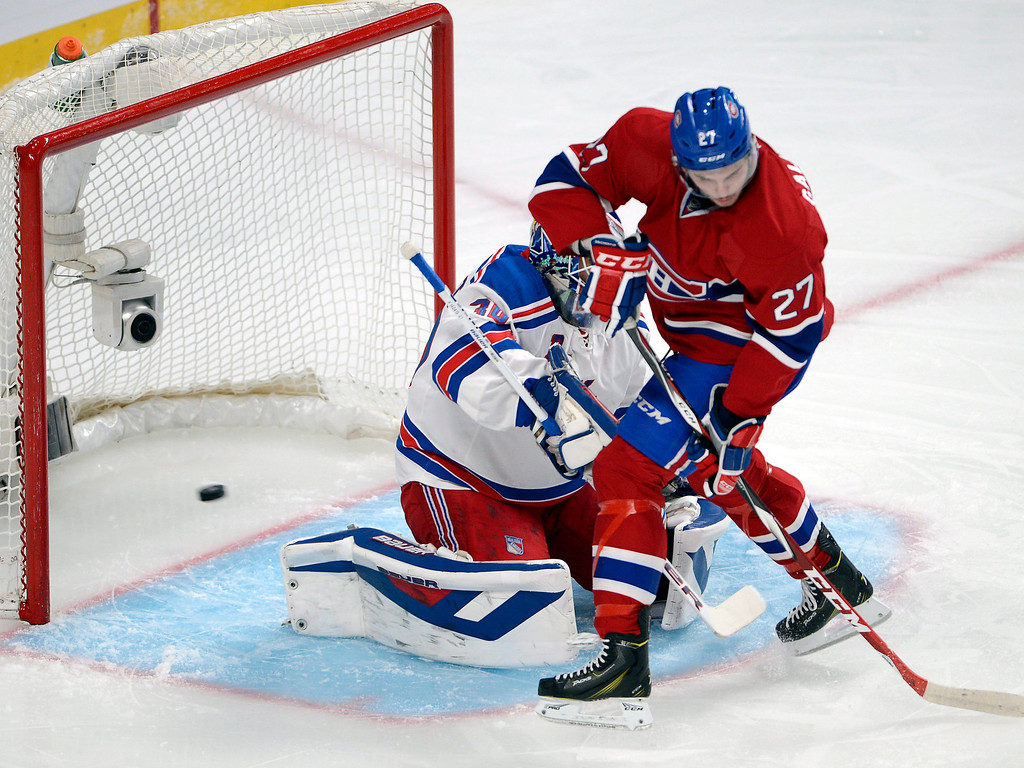 . CORRECTS CANADIENS PLAYER TO ALEX GALCHENYUK, WHO SCORED THE GOAL - Montreal Canadiens\' Alex Galchenyuk stands in front of New York Rangers goalie Henrik Lundqvist as a goal by Galchenyuk enters the net during the first period of Game 5 of the NHL hockey Stanley Cup playoffs Eastern Conference finals, Tuesday, May 27, 2014, in Montreal. (AP Photo/The Canadian Press, Ryan Remiorz)