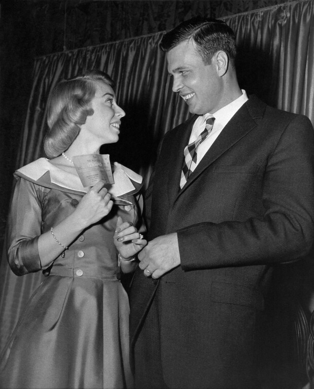 """. Dr. Joyce Brothers of New York, shows a check for $64,000 in New York  Dec. 7, 1955 which she won on the TV program \""""The $64,000 Question\"""" to Stanley Skeens of Danville, W. Va. She won the top prize through her knowledge of boxing. Skeens answering a question on the Bible, reached the $32,000 level and may try for double that amount. (AP Photo)"""