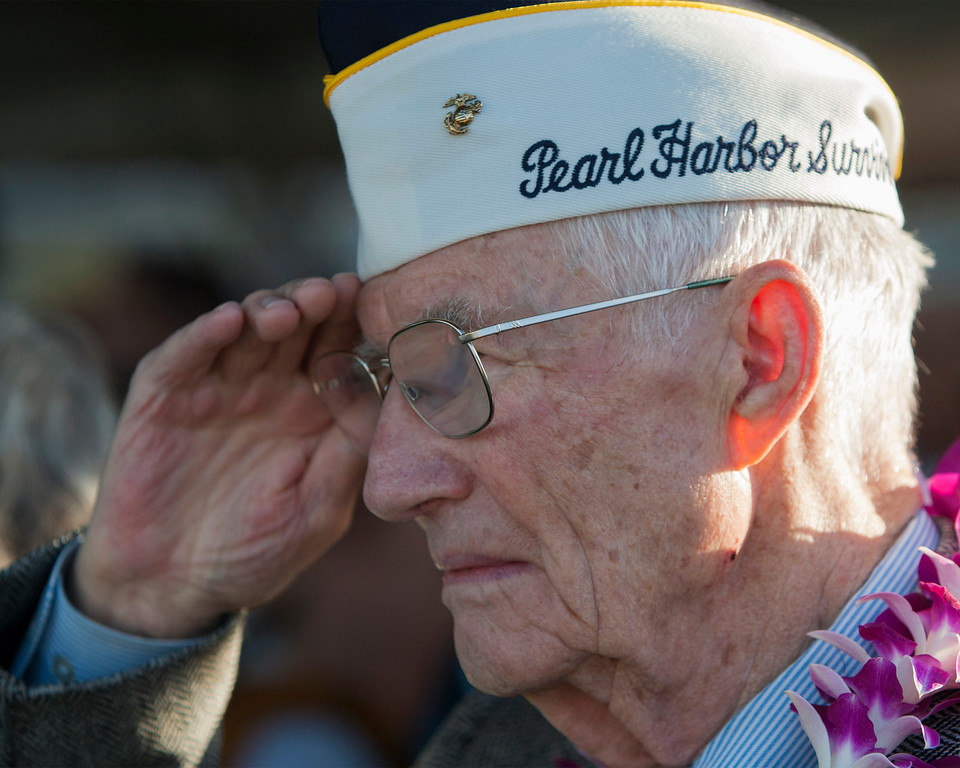 . Pearl Harbor survivor John R. Stevens salutes the flag at the start of ceremony commemorating the 72nd anniversary of the attack on Pearl Harbor, Saturday, Dec. 7, 2013, in Honolulu.  (AP Photo/Marco Garcia)