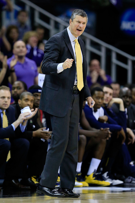 . KANSAS CITY, MO - MARCH 22: Head coach John Giannini of the La Salle Explorers reacts in the second half against the Kansas State Wildcats during the second round of the 2013 NCAA Men\'s Basketball Tournament at the Sprint Center on March 22, 2013 in Kansas City, Missouri.  (Photo by Jamie Squire/Getty Images)