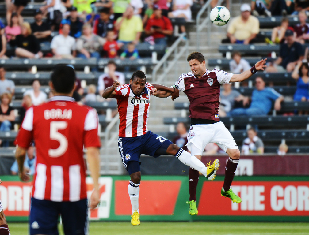 . COMMERCE CITY, CO. - MAY 25: Drew Moor of Colorado Rapids (3), right, and  Jose Correa of Chivas USA (27) are fighting for the control of ball during the 1st half of the game at Dick\'s Sporting Goods Park. Commerce City, Colorado. May 25, 2013. (Photo By Hyoung Chang/The Denver Post)