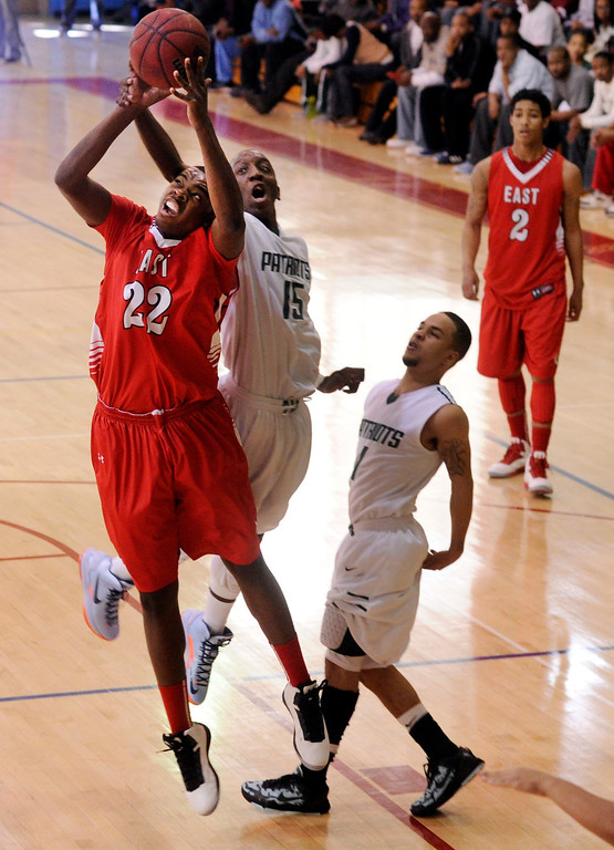 . DENVER, CO. - FEBRUARY 16: Patriots senior Jalen Johnson (15) catches Angels forward Triston Terroade (22) on the wrist in the first quarter. The Denver East High School boy\'s basketball team defeated George Washington 82-20 Saturday afternoon, February 16, 2013.  (Photo By Karl Gehring/The Denver Post)