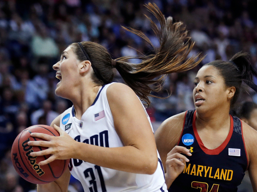 . Connecticut center Stefanie Dolson pivots to the basket against Maryland forward Tianna Hawkins during the second half of an NCAA women\'s college basketball tournament regional semifinal in Bridgeport, Conn., Saturday, March 30, 2013. Connecticut won 76-50. (AP Photo/Charles Krupa)