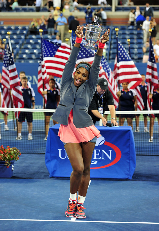 . Serena Williams of the US holds the trophy as she celebrates her win over Victoria Azarenka of Belarus during their 2013 US Open women\'s singles final match at the USTA Billie Jean King National Tennis Center September 8, 2013 in New York.   STAN HONDA/AFP/Getty Images