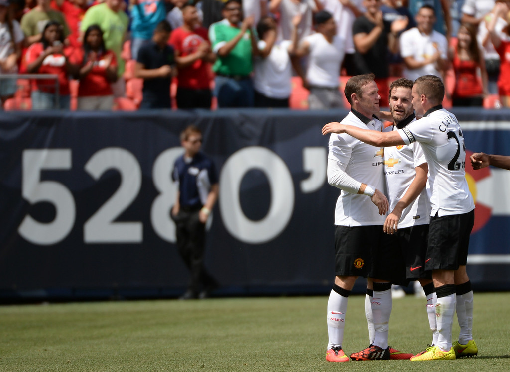 . From left, Wayne Rooney (10), Juan Mata (8) and Tom Cleverley (23) of Manchester United celebrate Mata\'s goal in the 1st half of the game against AS Roma in Guinness International Champions Cup 2014 at Sports Authority Field at Mile High. Denver, Colorado. July 26. 2014. (Photo by Hyoung Chang/The Denver Post)