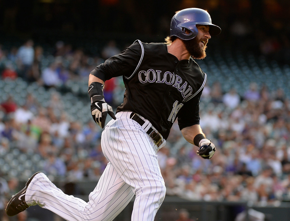 . Colorado Rockies center fielder Charlie Blackmon (19) rounds first base on his way to second base for a double during the first inning against the San Diego Padres July 8, 2014 at Coors Field. (Photo by John Leyba/The Denver Post)