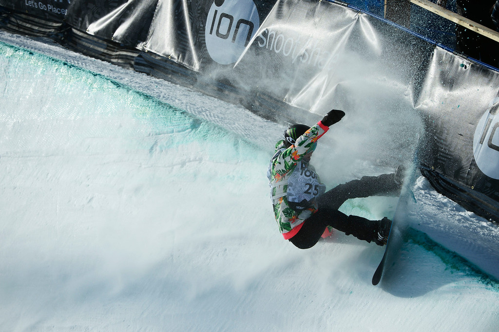 . Pro Snowboarder, Kaitlyn Farrington, sprays snow in the superpipe at Breckenridge during the Dew Tour Ion Mountain superpipe championship finals at Breckenridge Saturday afternoon, December 14, 2013.  (Photo By Andy Cross/The Denver Post)