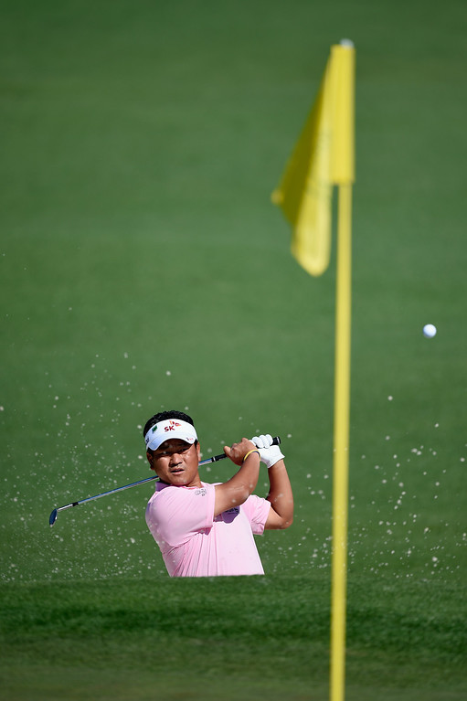 . K.J. Choi of South Korea plays a bunker shot on the second hole during the first round of the 2014 Masters Tournament at Augusta National Golf Club on April 10, 2014 in Augusta, Georgia.  (Photo by Harry How/Getty Images)