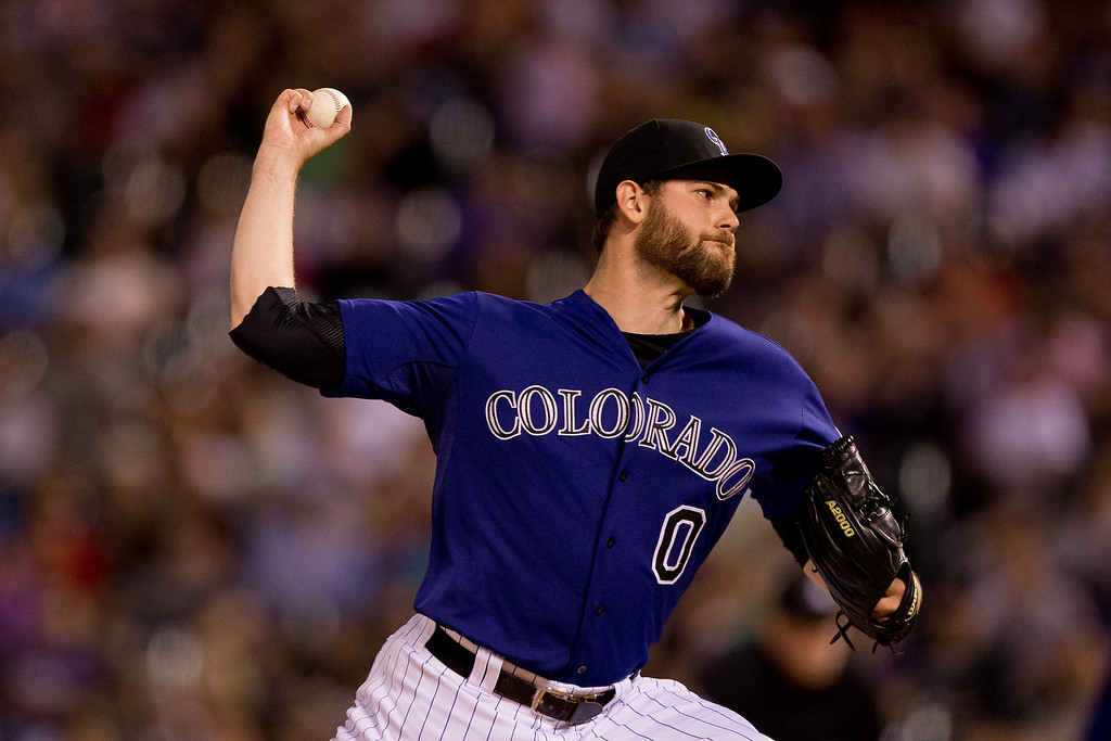 . Adam Ottavino #0 of the Colorado Rockies pitches during the eighth inning against the Atlanta Braves at Coors Field on June 9, 2014 in Denver, Colorado.  (Photo by Justin Edmonds/Getty Images)