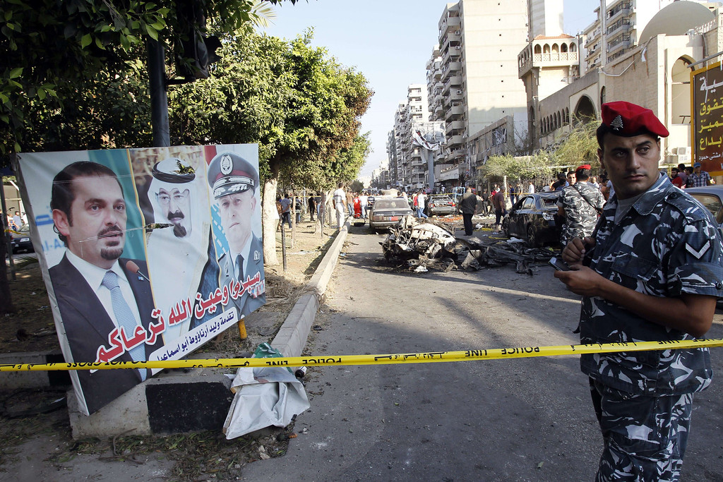 . A member of the Internal Security Forces (ISF) stands guard next to the site of a blast outside the Al-Salam mosque in the northern city of Tripoli on August 23, 2013.  AFP PHOTO/ANWAR  AMRO/AFP/Getty Images