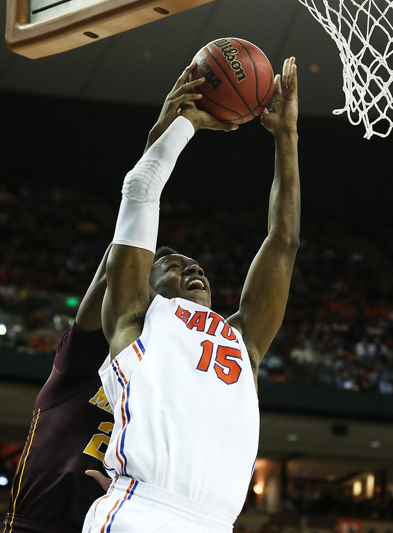 . Will Yeguete #15 of the Florida Gators goes up against Austin Hollins #20 of the Minnesota Golden Gophers in the second half during the third round of the 2013 NCAA Men\'s Basketball Tournament at The Frank Erwin Center on March 24, 2013 in Austin, Texas.  (Photo by Stephen Dunn/Getty Images)