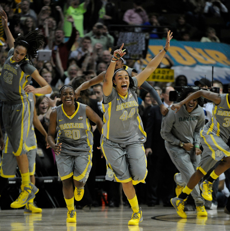 . Baylor Bears teammates lead by Ashley Field (24) clear the bench after defeating Notre Dame 80-61 in NCAA Women\'s 2012 National Championship action at the Pepsi Center in Denver, CO Tuesday April 3, 2012.  John Leyba/The Denver Post