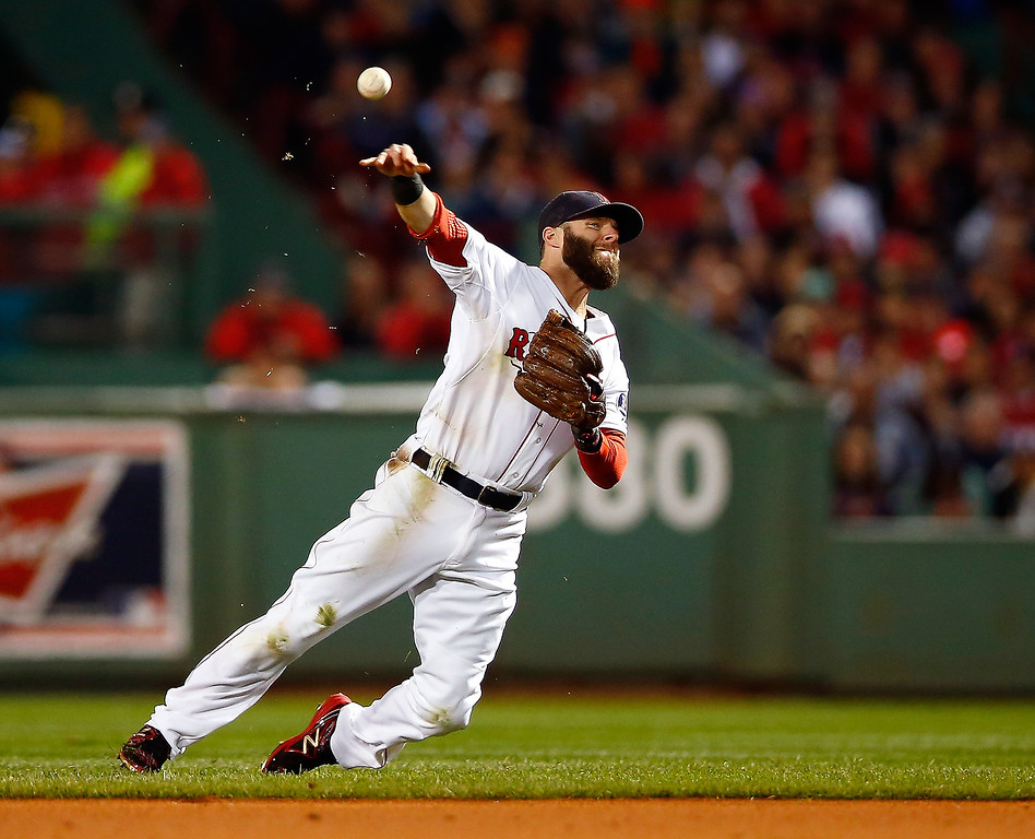 . Dustin Pedroia #15 of the Boston Red Sox throws to first base in the third inning against the Detroit Tigers during Game Two of the American League Championship Series at Fenway Park on October 13, 2013 in Boston, Massachusetts.  (Photo by Jared Wickerham/Getty Images)