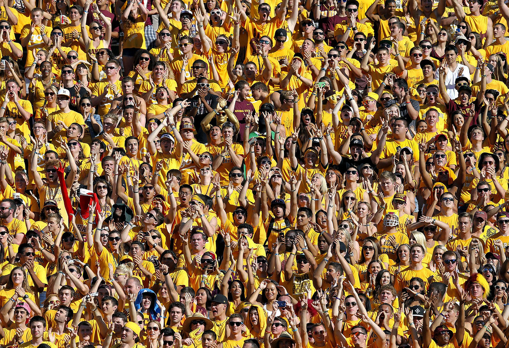 . Arizona State fans cheer during the first half of an NCAA college football game against Washington, Saturday, Oct. 19, 2013, in Tempe, Ariz. (AP Photo/Matt York)