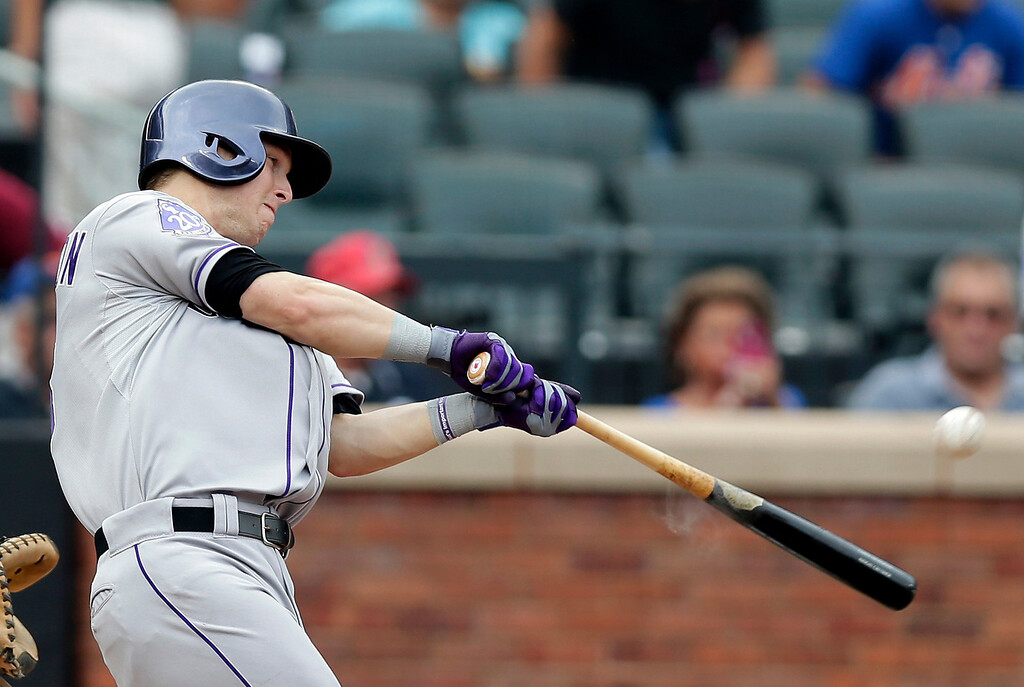 . Colorado Rockies Corey Dickerson hits a solo home run off New York Mets starting pitcher Dillon Gee during the fourth inning of a baseball game in New York, Thursday, Aug. 8, 2013. (AP Photo/Kathy Willens)