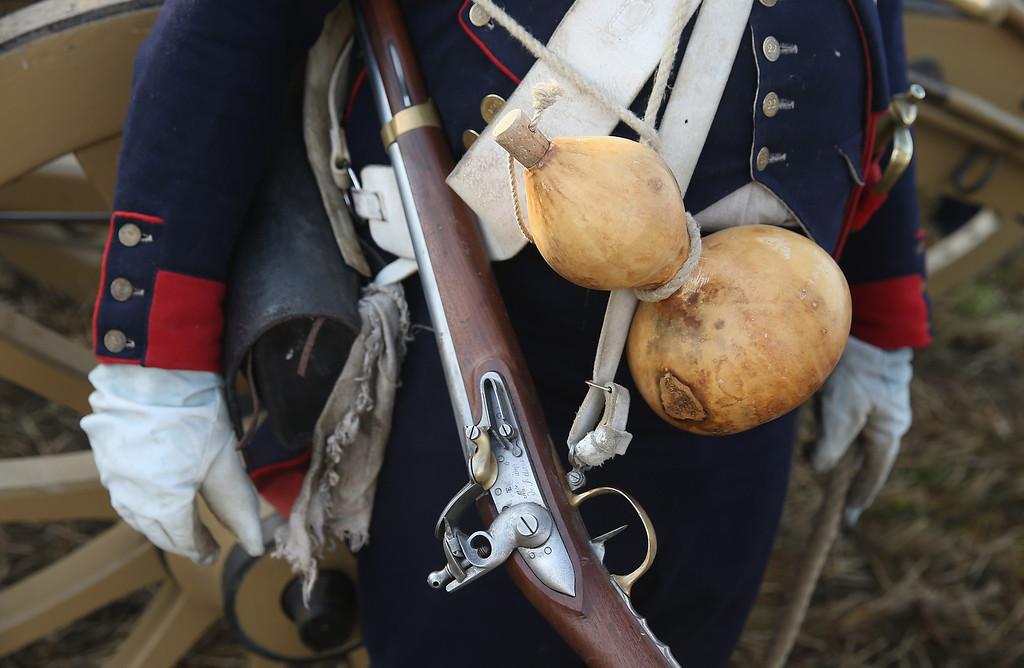 . A historical society enthusiast in the role of a French artillery soldier fighting under Napoleon take arrives with a musket and water gourd to re-enact The Battle of Nations on its 200th anniversary on October 20, 2013 near Leipzig, Germany. (Photo by Sean Gallup/Getty Images)