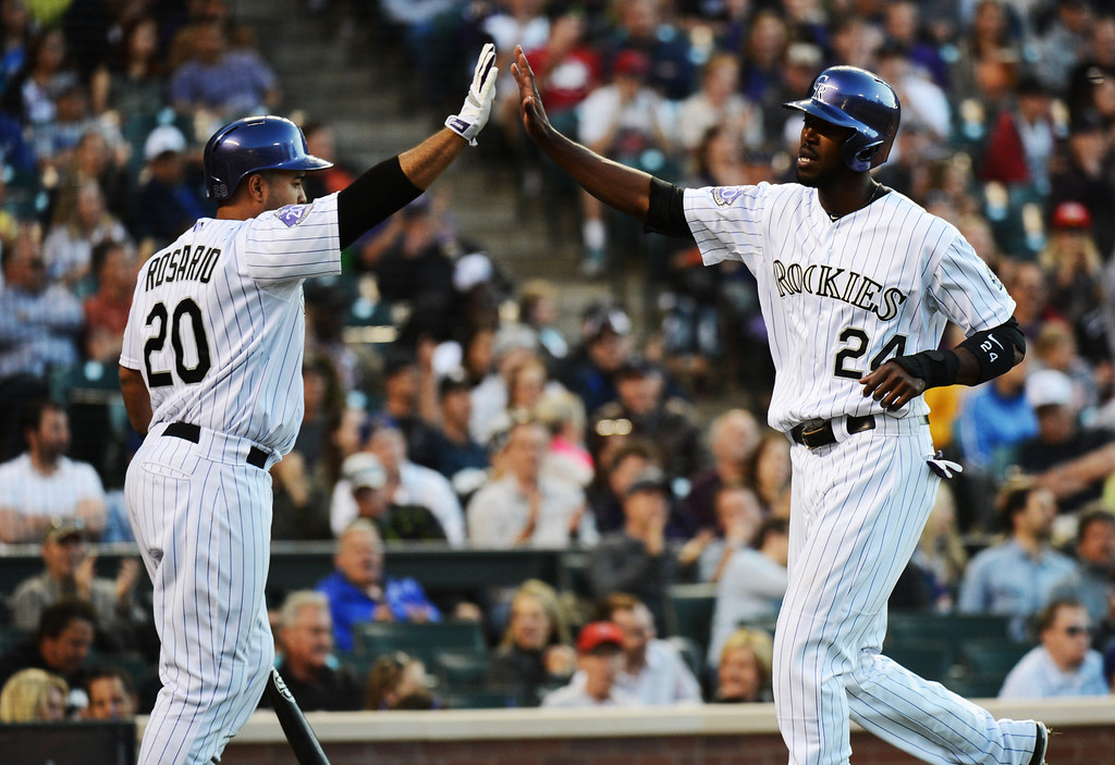 . DENVER, CO. - MAY 31: Dexter Fowler of Colorado Rockies (24) and Wilin Rosario (20) celebrate Lowler\'s scoring in the 4th inning of the game againsts Los Angeles Dodgers at Coors Field. Denver, Colorado. May 31, 2013. (Photo By Hyoung Chang/The Denver Post)
