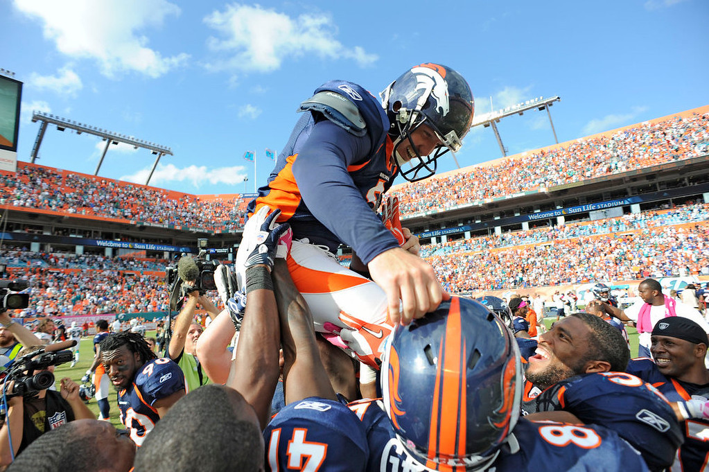 . Denver Broncos kicker Matt Prater (5) is lifted up by teammates after kicking a 52-yard FG in overtime  for the win 18-15 over the Miami Dolphins October 23, 2011 at Sun Life Stadium in Miami Gardens.  The Denver Post / John Leyba