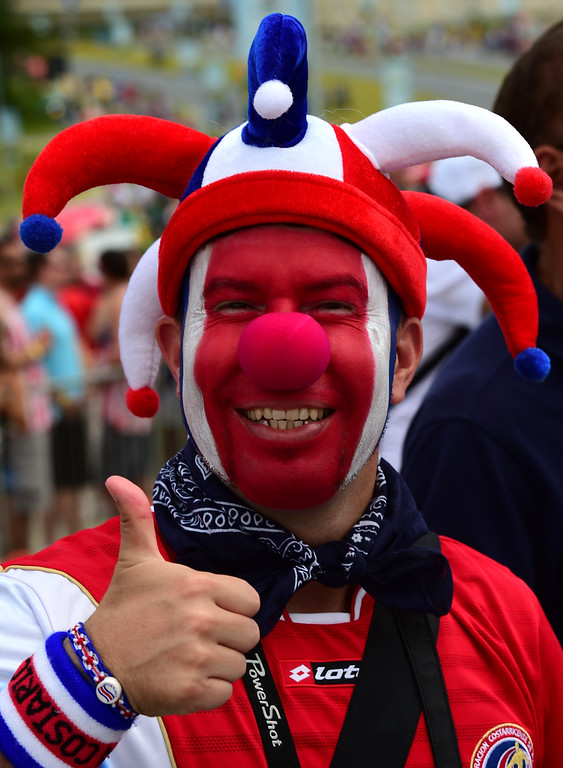 . A Costa Rica fan cheers prior to a Group D football match between Italy and Costa Rica at the Pernambuco Arena in Recife during the 2014 FIFA World Cup on June 20, 2014.     AFP PHOTO / RONALDO SCHEMIDT/AFP/Getty Images
