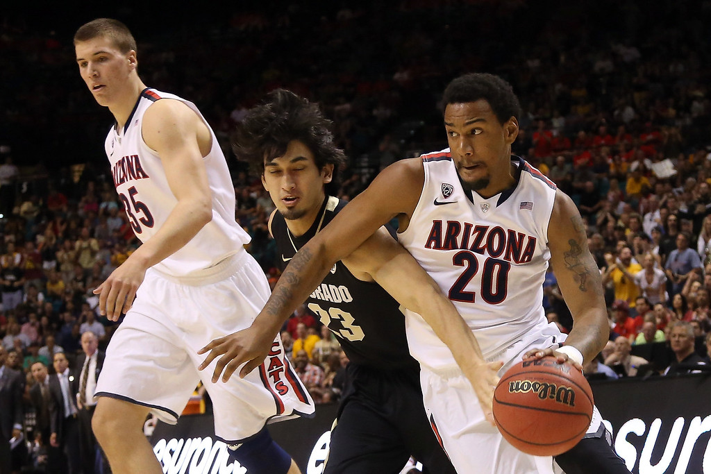 . Jordin Mayes #20 of the Arizona Wildcats drives on Sabatino Chen #23 of the Colorado Buffaloes in the second half during the quarterfinals of the Pac-12 tournament at the MGM Grand Garden Arena on March 14, 2013 in Las Vegas, Nevada.  (Photo by Jeff Gross/Getty Images)