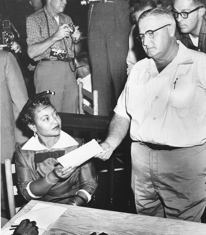 . Mamie Bradley, mother of Emmett Louis Till, is served with a subpoena to appear as a witness in the trial of two Mississippi men who are accused of murdering her 14-year-old son, in Tallahatchie, Miss., on September 20, 1955. Sheriff H.C. Strider presents the subpoena shortly after Mrs. Bradley arrived at the Tallahatchie County courtroom. (AP Photo)