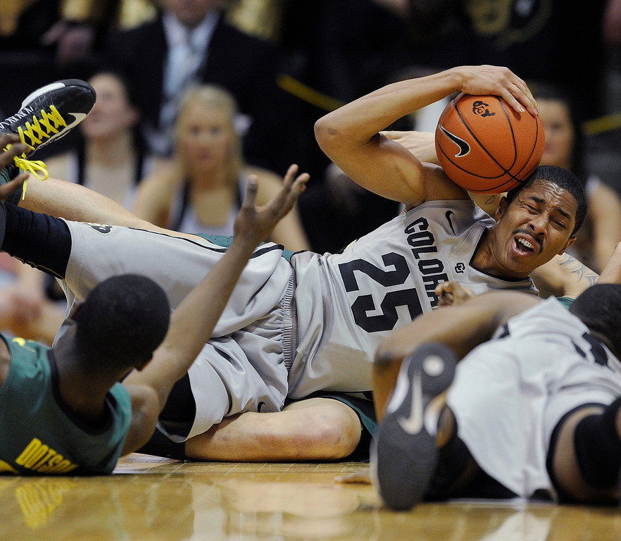 . BOULDER, CO. - MARCH 7: Colorado guard Spencer Dinwiddie (25) went to the floor to secure a loose ball in the second half. The University of Colorado men\'s basketball team defeated Oregon 76-53 Thursday night, March 7, 2013 at the CU Events Center in Boulder. (Photo By Karl Gehring/The Denver Post)