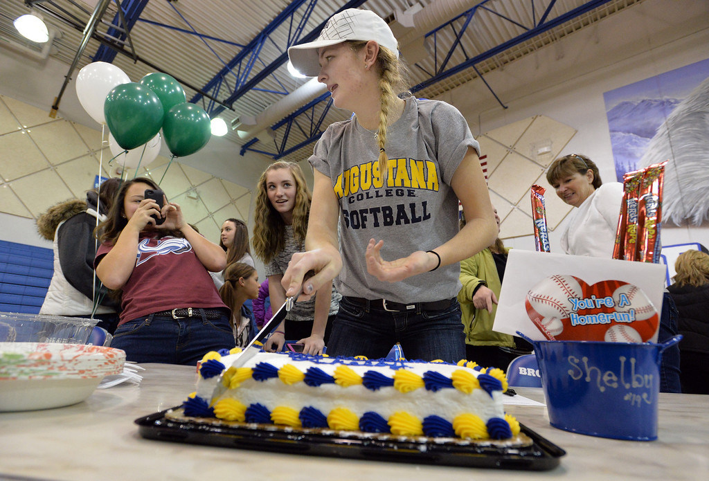 . Broomfield\'s Shelby Grant  prepares to cut her cake after signing to Augustana College for softball during National Signing Day at Broomfield High.  For more photos and video please go to broomfieldenterprise.com. February 5, 2014 staff photo/ David R. Jennings