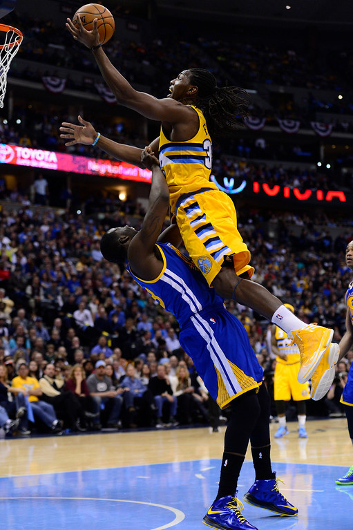 . DENVER, CO. - APRIL 23: Denver Nuggets small forward Kenneth Faried (35) commits an offensive could against Golden State Warriors small forward Draymond Green (23) in the third quarter. The Denver Nuggets took on the Golden State Warriors in Game 2 of the Western Conference First Round Series at the Pepsi Center in Denver, Colo. on April 23, 2013. (Photo by AAron Ontiveroz/The Denver Post)