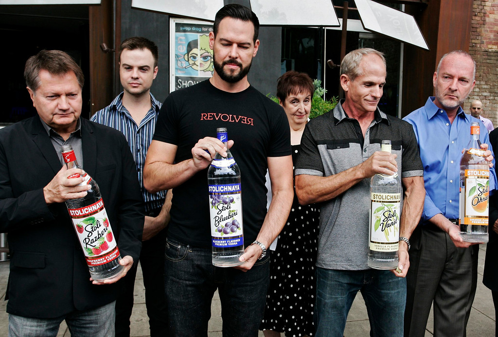 . Michael Niemeyer (L-R), Matthew Ervin, Alfredo Diaz, Richard Grossi, and Rodney Scott prepare to empty Russian vodka bottles filled with water, into the gutter during a news conference at Micky\'s nightclub in West Hollywood, California August 1, 2013. Bar owners, city officials and members of lesbian, gay, bisexual, and transgender (LGBT) organizations participated in the event to announce a boycott of Russian vodkas to protest new laws in Russia targeting homosexuals, according to a news release by the organizers. REUTERS/Jonathan Alcorn