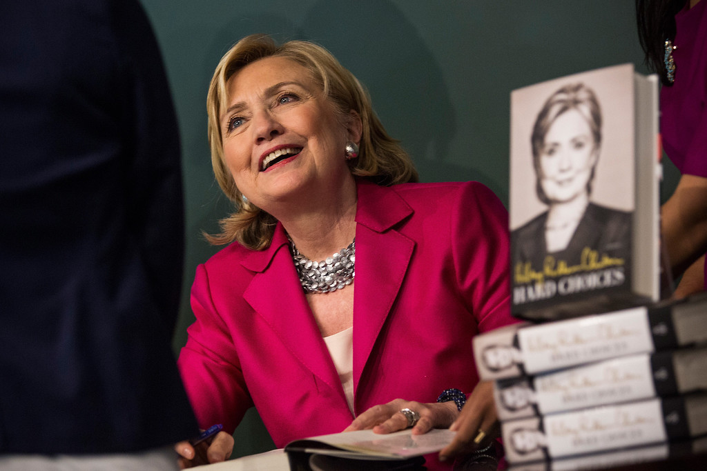 """. Former Secretary of State Hillary Clinton meets with people during a book signing for her new book, \""""Hard Choices\"""" at a Barnes & Noble on June 10, 2014 in New York City. (Photo by Andrew Burton/Getty Images)"""