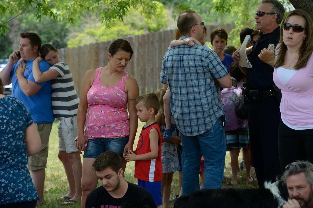 . Neighbors gather near the scene of the house explosion.  (Photo By Andy Cross/The Denver Post)