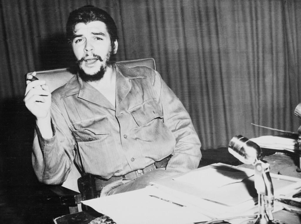 ". Major Ernesto \""Che\"" Guevara is shown at his desk with cigar in hand in Havana, Cuba, Oct. 20, 1960.  (AP Photo)"