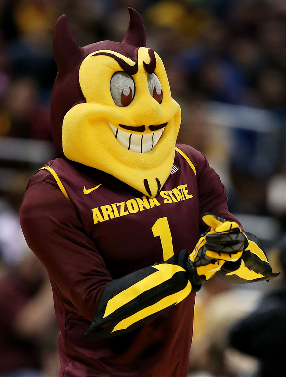 . Arizona State Sun Devils mascot Sparky looks on in the second half against the Texas Longhorns during the second round of the 2014 NCAA Men\'s Basketball Tournament at BMO Harris Bradley Center on March 20, 2014 in Milwaukee, Wisconsin.  (Photo by Jonathan Daniel/Getty Images)