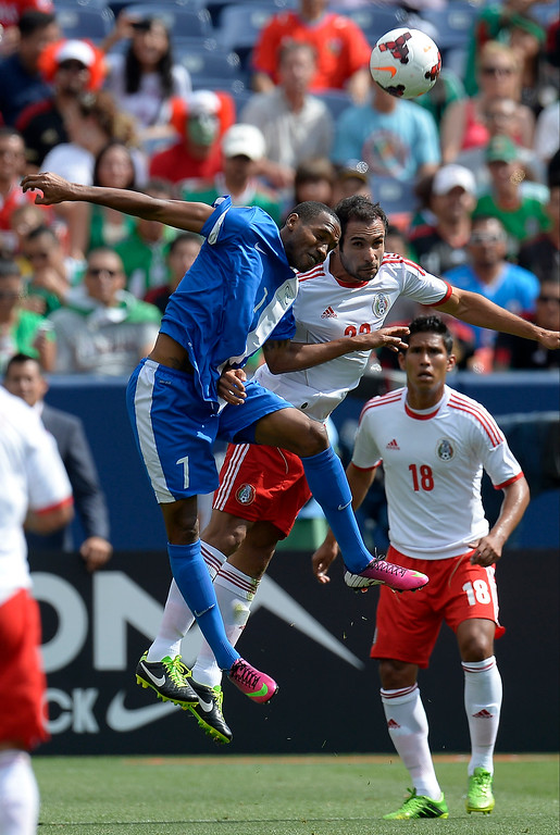 . Steve Guston #7 of Martinique and Alejandro Castro #22 of Mexico goes up fro the ball during the first half in the CONCACAF Gold Cup soccer game July 14, 2013 at Sports Authority Field at Mile High. (Photo By John Leyba/The Denver Post)