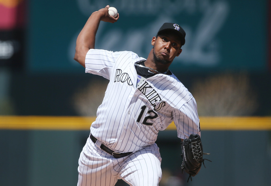 . Colorado Rockies starting pitcher Juan Nicasio works against the Philadelphia Phillies in the first inning of a baseball game in Denver on Sunday, April 20, 2014. (AP Photo/David Zalubowski)