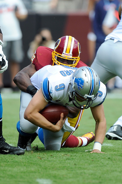 . London Fletcher #59 of the Washington Redskins sacks Matthew Stafford #9 of the Detroit Lions during the first quarter at FedExField on September 22, 2013 in Landover, Maryland.  (Photo by Greg Fiume/Getty Images)