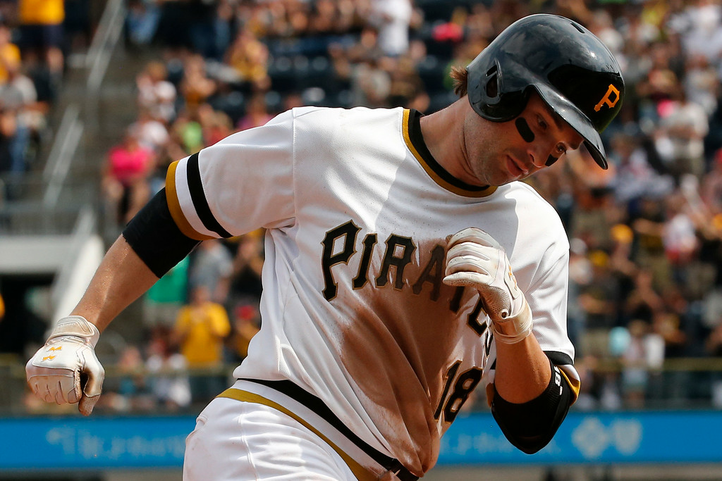 . Pittsburgh Pirates\' Neil Walker rounds third after hitting a solo home run off Colorado Rockies relief pitcher Matt Belisle during the seventh inning of a baseball game in Pittsburgh, Sunday, July 20, 2014. The Pirates won 5-3. (AP Photo/Gene J. Puskar)