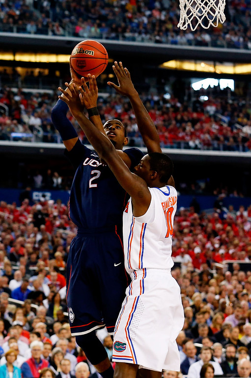 . ARLINGTON, TX - APRIL 05: DeAndre Daniels #2 of the Connecticut Huskies goes up for a shot as Dorian Finney-Smith #10 of the Florida Gators defends during the NCAA Men\'s Final Four Semifinal at AT&T Stadium on April 5, 2014 in Arlington, Texas.  (Photo by Tom Pennington/Getty Images)