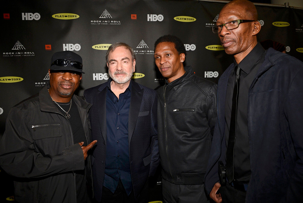 . Singer Neil Diamond stands with inductees Chuck D (L), and other members of Public Enemy at the 2013 Rock and Roll Hall of Fame induction ceremony in Los Angeles April 18, 2013.   REUTERS/Phil McCarten