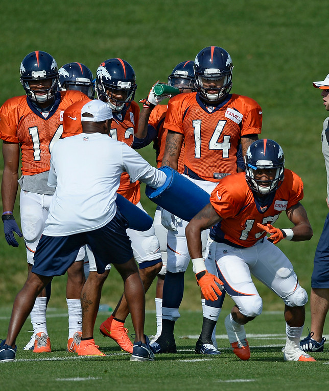 . Denver Broncos wide receiver Nathan Palmer (13) runs through drills on day five of the Denver Broncos 2014 training camp July 28, 2014 at Dove Valley. (Photo by John Leyba/The Denver Post)