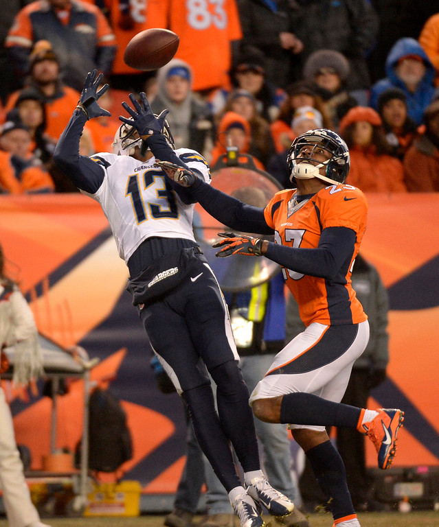 . Denver Broncos cornerback Quentin Jammer (23) gets beat in the end zone for a touchdown by San Diego Chargers wide receiver Keenan Allen (13) during the fourth quarter. The Denver Broncos vs. The San Diego Chargers in an AFC Divisional Playoff game at Sports Authority Field at Mile High in Denver on January 12, 2014. (Photo by John Leyba/The Denver Post)
