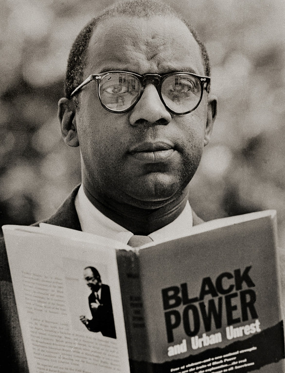 """. The Rev. Dr. Nathan Wright Jr. is shown with his book \""""Black Power and Urban Unrest\"""" in Orange, N.J., August 4, 1967. Dr. Wright, who is executive director of the department of urban work of the Episcopal Diocese of Newark, says the African American may have his Irish up but he took the cue from white men\'s ancestors. He contends that white minorities used \""""group power for self directed efforts at self sufficiency and self respect.\"""" (AP Photo)"""