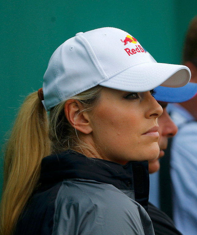 . Skier Lindsey Vonn watches her boyfriend, Tiger Woods of the U.S., during the final round of the British Open golf championship at Muirfield in Scotland July 21, 2013. REUTERS/Brian Snyder