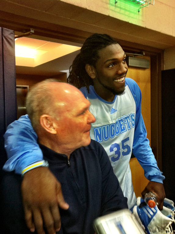 . Nuggets forward Kenneth Faried jokes around after practice Friday with coach George Karl. Faried turned into a reporter, asking the coach a few questions with the regular media. Benjamin Hochman, The Denver Post