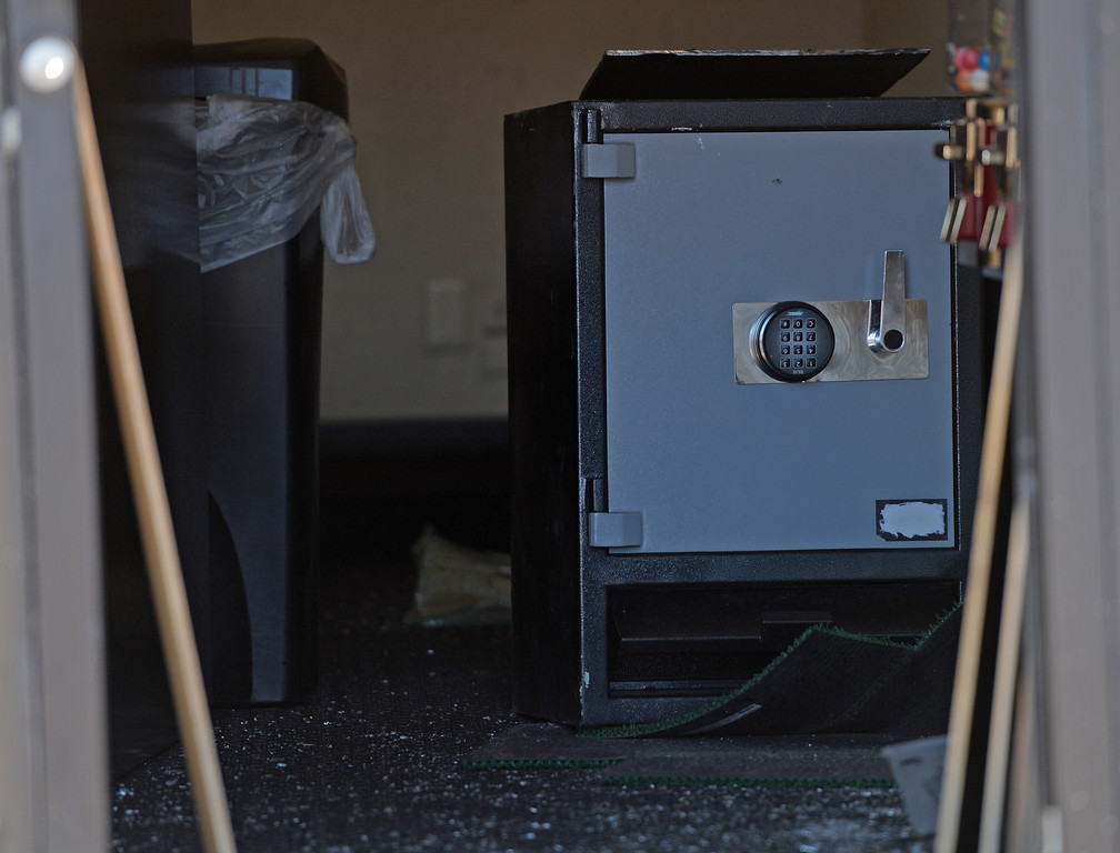 . Drug Enforcement Agency officials cut into a safe during a raid at VIP Cannabis, located at 2949 W. Alameda Ave., April 30, 2014. The marijuana dispensary was previously raided in November 2013. (Photo by RJ Sangosti/The Denver Post)